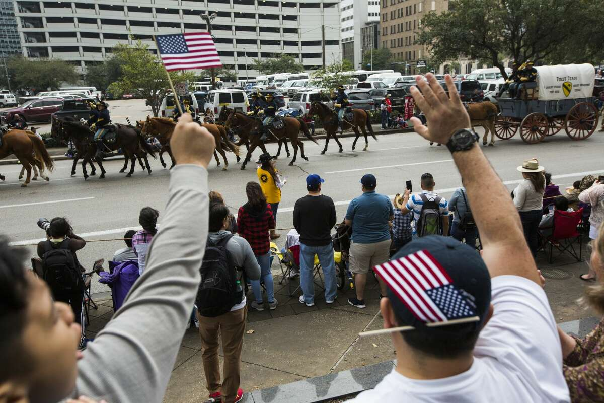 The 1st Cavalry Division rides pass observes cheering during the 2019 Houston Rodeo Parade on Saturday, Feb. 23, 2019, in Houston.
