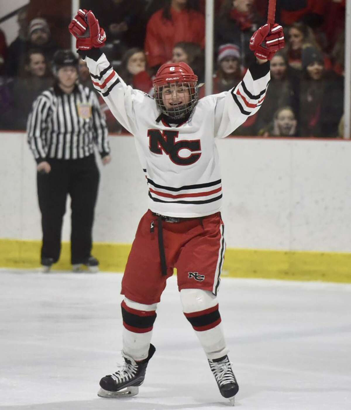 New Canaan freshman Kaleigh Harden celebrates after assisting on Anika Curri's goal in the first period of the FCIAC girls hockey final at the Darien Ice House on Saturday, Feb. 23.