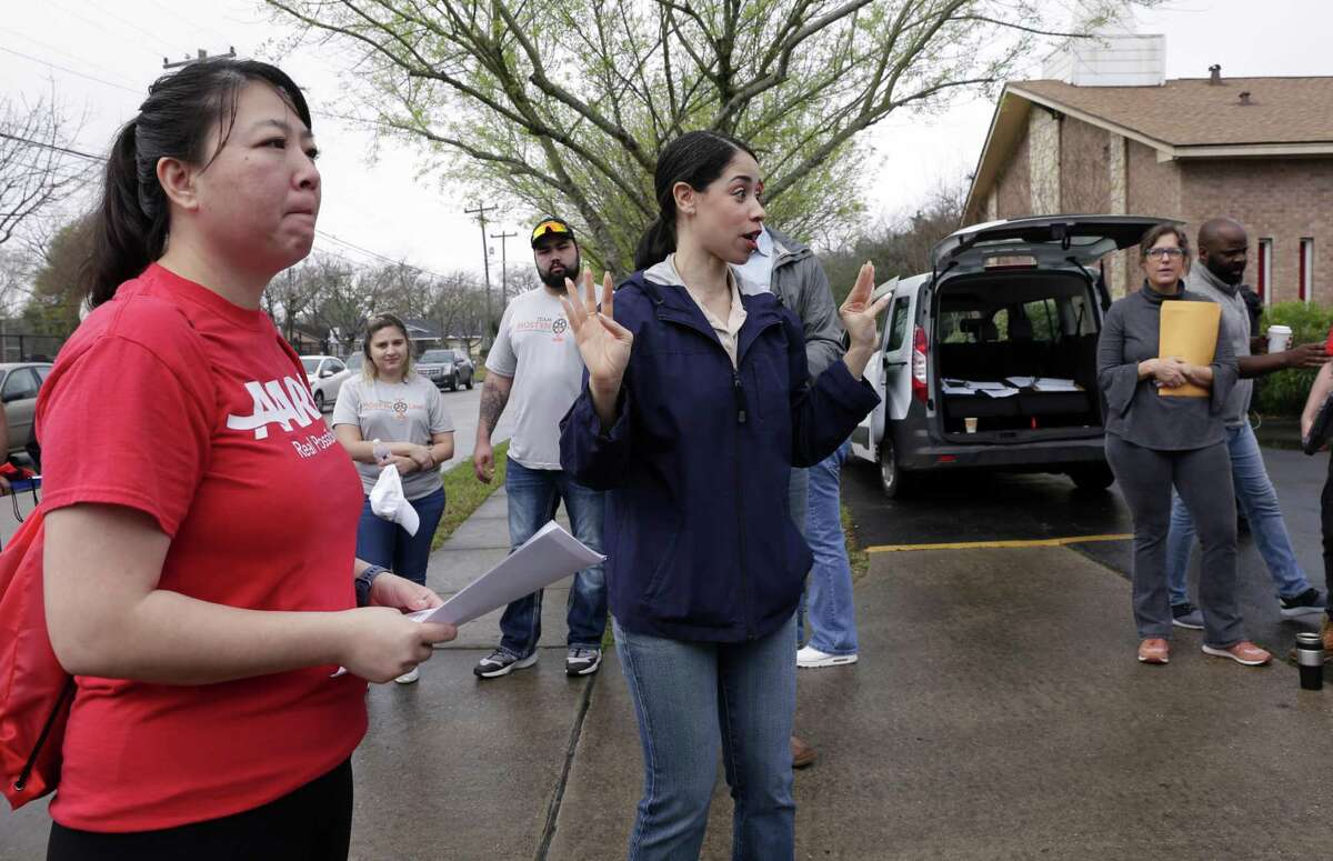 Tina Tran, left, listens with other staff and volunteers as Houston city council member Amanda K. Edwards, center, gives instructions before they all head out to canvas houses affected by the floods of Hurricane Harvey in the Kashmere Gardens neighborhood Saturday, Feb. 23, 2019 in Houston, TX.