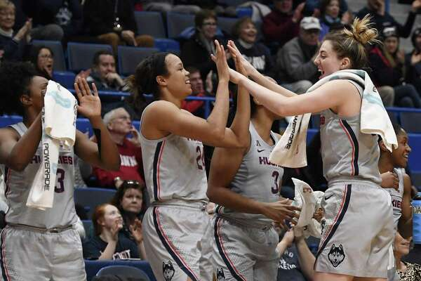UConn's Katie Lou Samuelson, right, slaps hands with teammate Napheesa Collier during the second half against Memphis on Wednesday in Hartford.