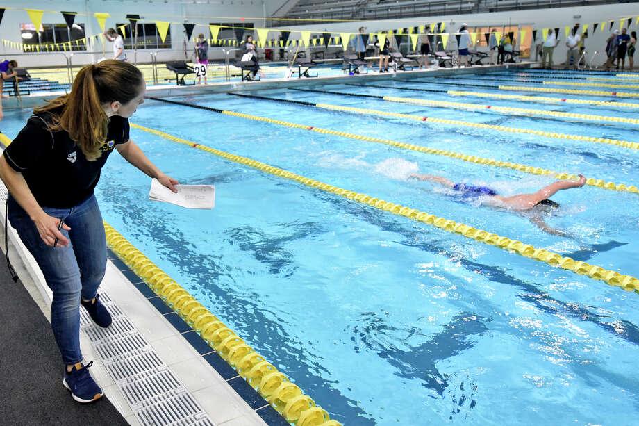 COM swim coach Jenna Purkey encourages a swimmer during the West Texas Championships meet Feb. 22, 2019, at COM Aquatics. James Durbin/Reporter-Telegram Photo: James Durbin / © 2019 Midland Reporter-Telegram. All Rights Reserved.