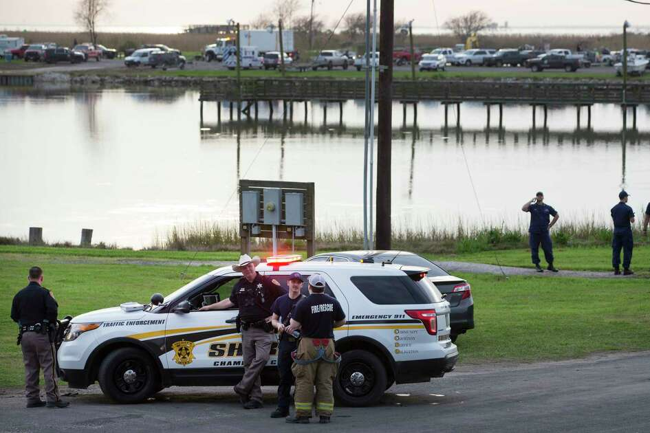 Law enforcement officers man a road block leading to a staging area during the investigation of a plane crash in Trinity Bay on Saturday, Feb. 23, 2019, in Anahuac. Hawthorne said that human remains were recovered from the site. He would not say how many, only that they were recovered outside the cockpit. The Federal Aviation Administration said a Boeing 767 cargo plane went down shortly before 12:45 p.m., which is approximately 30 miles southeast of George Bush Intercontinental Airport.