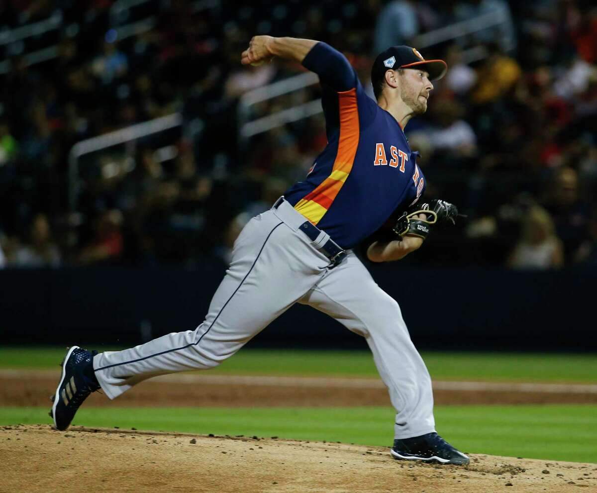 Houston Astros right handed pitcher Brady Rodgers (52) pitches during the bottom first inning of the Houston Astros-Washington Nationals spring training opening game at Fitteam Ballpark of The Palm Beaches on Saturday, Feb. 23, 2019, in West Palm Beach.