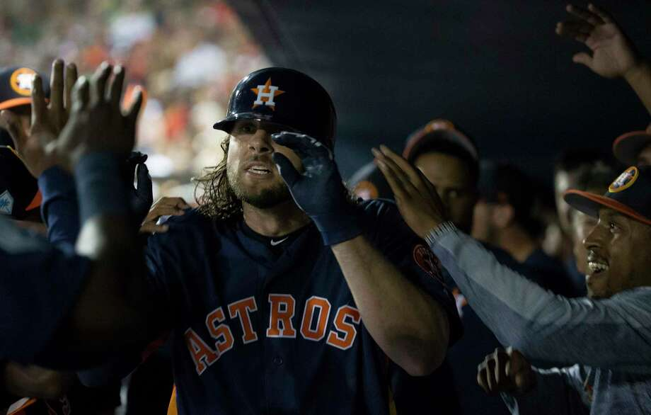 Houston Astros outfielder Jake Marisnick (6) is congratulated by teammates in the dugout after his lead-off home run during the top first inning of the Houston Astros-Washington Nationals spring training opening game at Fitteam Ballpark of The Palm Beaches on Saturday, Feb. 23, 2019, in West Palm Beach. Photo: Yi-Chin Lee, Staff Photographer / © 2019 Houston Chronicle