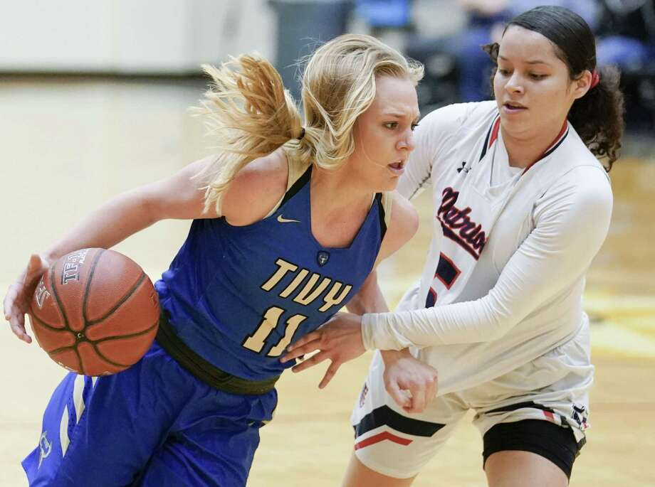 Tivy's Charli Becker (11) drives against Veterans Memorial guard Vivian Castro during a girls high school basketball regional championship game, Saturday, Feb. 23, 2019, in San Antonio. Tivy won 44-34. (Darren Abate/Contributor) Photo: Darren Abate, FRE / Darren Abate