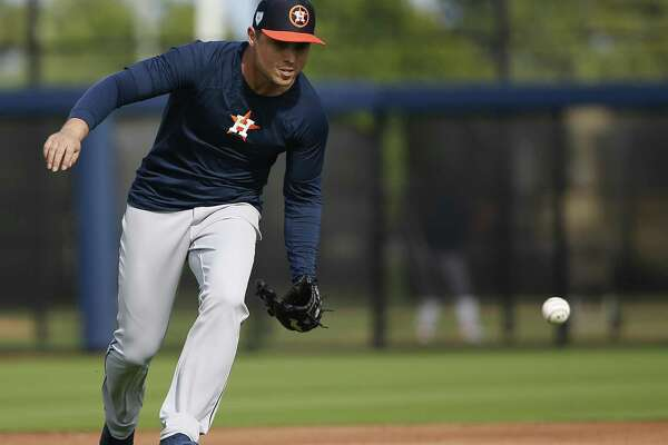Houston Astros infielder Aledmys Diaz (16) catches a ground ball during defense drills at Fitteam Ballpark of The Palm Beaches on Day 10 of spring training on Saturday, Feb. 23, 2019, in West Palm Beach.