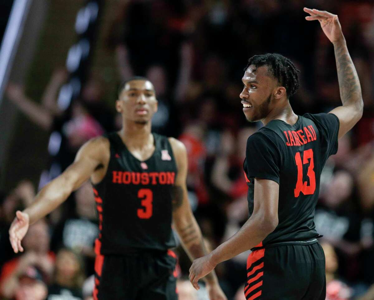 Houston guard Dejon Jarreau, right, reacts after a Cougars' three point basket as teammate Armoni Brooks watches during the second half of an NCAA college basketball game against South Florida, Saturday, Feb. 23, 2019, in Houston. Houston won the game 71-59.
