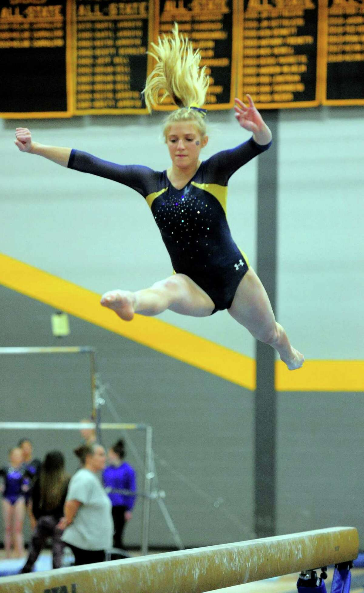 Woodstock Academy's Lydia Taft competes on the balance beam during CIAC Class S Gymnastics Championship action in Milford, Conn., on Saturday Feb. 23, 2019.