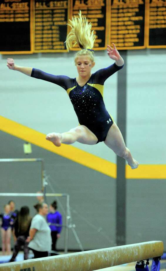 Woodstock Academy's Lydia Taft competes on the balance beam during CIAC Class S Gymnastics Championship action in Milford, Conn., on Saturday Feb. 23, 2019. Photo: Christian Abraham / Hearst Connecticut Media / Connecticut Post