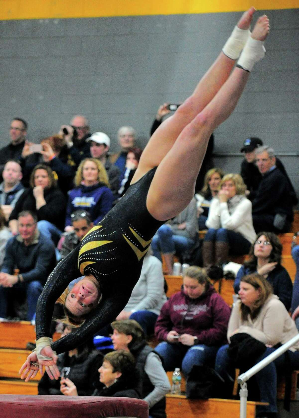 Hand's Grace Rogers competes on the vault during the CIAC Class S Gymnastics championships in Milford on Saturday.