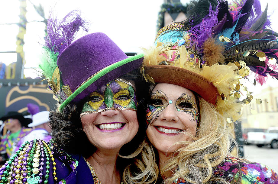 Krewe De Mon Amis members, including Jeannie Istre and Kellie Derouen, get the party started before the Krewe of Krewes Grande Parade highlighting Orange's Mardi Gras events Saturday.  Photo taken Saturday, February 23, 2019 Kim Brent/The Enterprise Photo: Kim Brent/The Enterprise