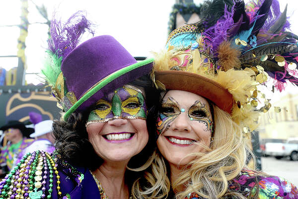 Krewe De Mon Amis members, including Jeannie Istre and Kellie Derouen, get the party started before the Krewe of Krewes Grande Parade highlighting Orange's Mardi Gras events Saturday. Photo taken Saturday, February 23, 2019 Kim Brent/The Enterprise