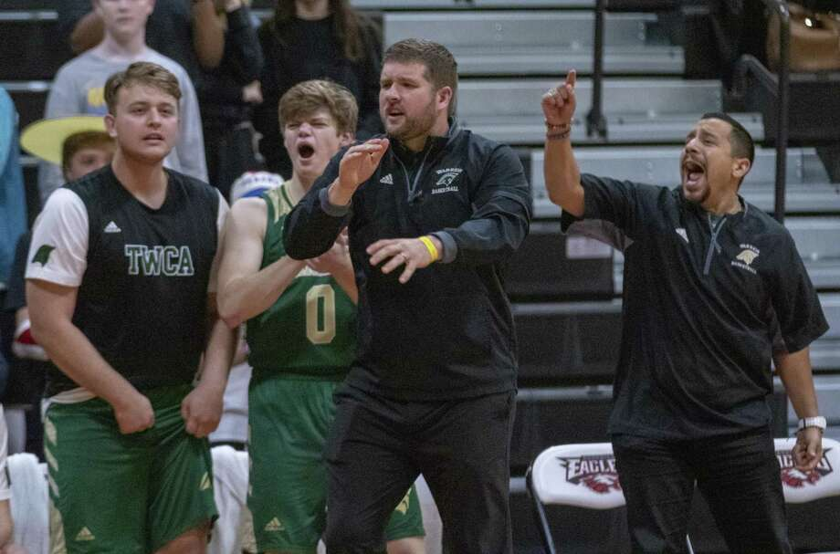 TWCA head basketball coach Tanner Field , center, and his team react to a score by TWCA junior Emanuel Jones (31) during a TAPPS Class 4A playoff basketball game Saturday, Feb. 23, 2019 at Rosehill Christian School in Tomball. Photo: Cody Bahn, Houston Chronicle / Staff Photographer / © 2018 Houston Chronicle