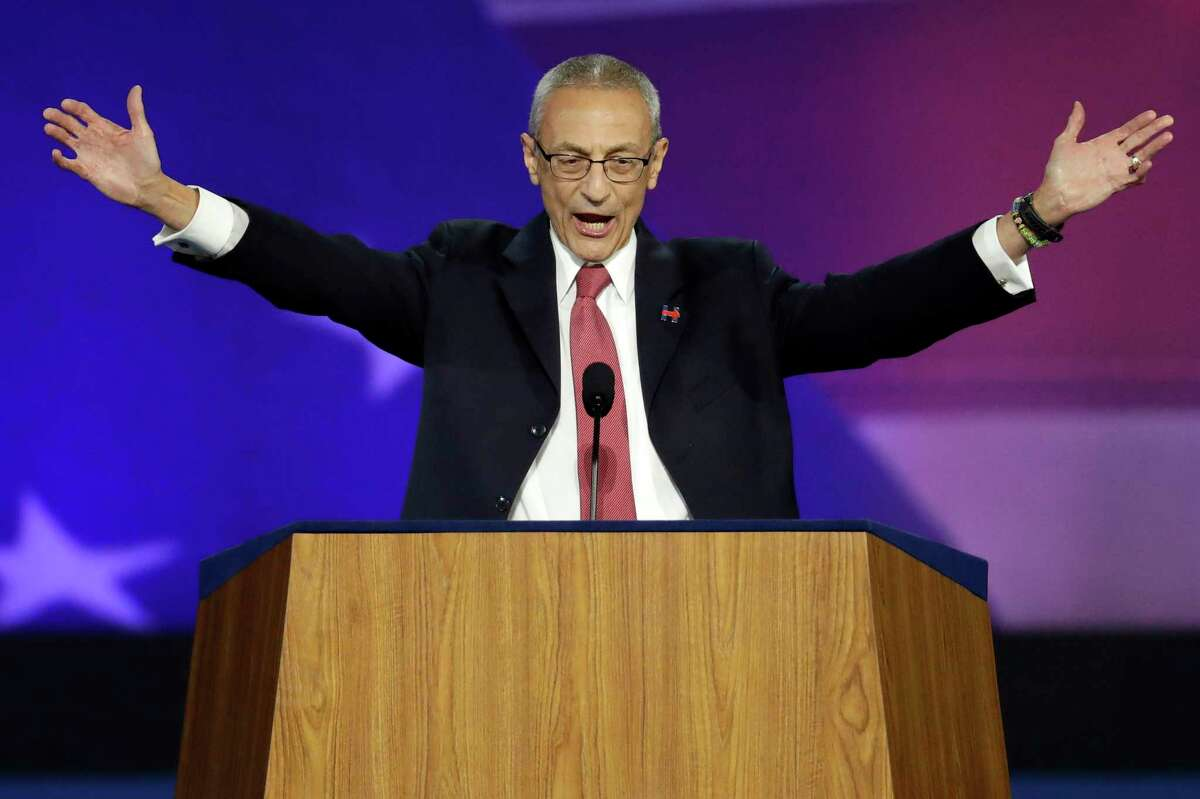 In this Nov. 9, 2016, file photo, John Podesta, campaign chairman, announces that Democratic presidential nominee Hillary Clinton will not be making an appearance at Jacob Javits Center in New York, as the votes are still being counted. (AP Photo/Patrick Semansky, File)