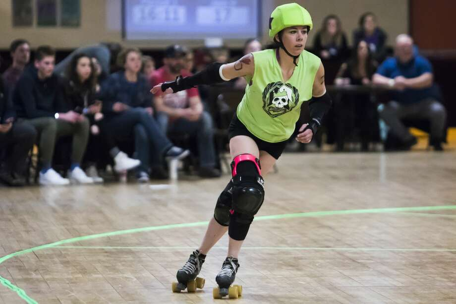 "Jessica Bateman, or ""Crazy,"" skates down the track during the Chemical City Derby Girls' annual Mardi Gras Massacre on Saturday, Feb. 23, 2019 at the Roll-Arena in Midland. (Katy Kildee/kkildee@mdn.net) Photo: (Katy Kildee/kkildee@mdn.net)"