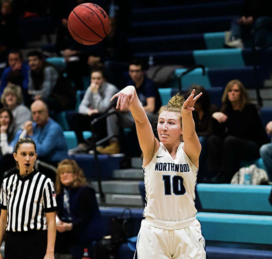 Northwood's Ellie Taylor takes a shot against Ashland during a game earlier this season. Taylor scored seven big points in overtime Saturday, as NU beat Wayne State to clinch its sixth straight GLIAC Tournament berth. Photo: Daily News File Photo