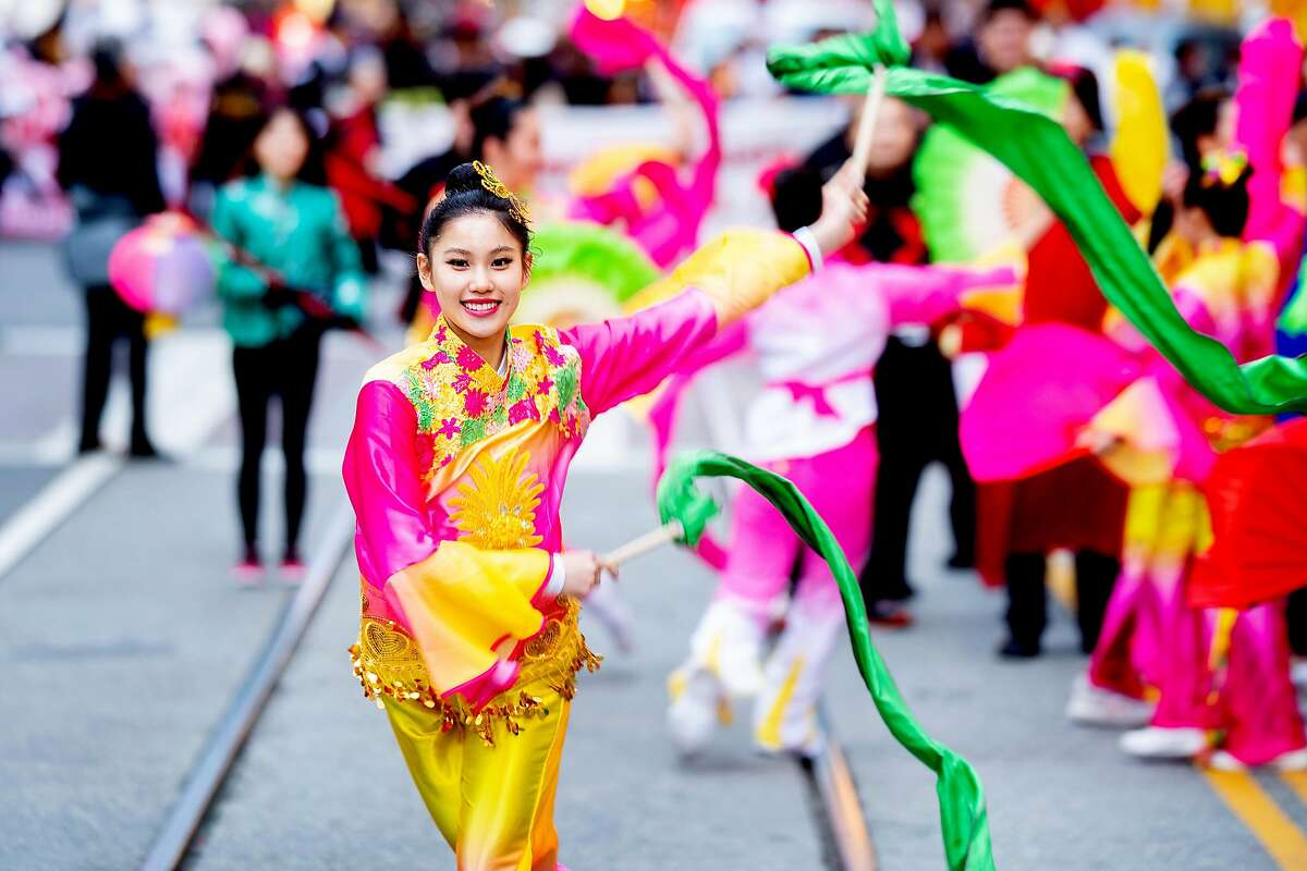 A performer from the Foster City Chinese Club dances during San Francisco's annual Chinese New Year Parade on Saturday, Feb. 23, 2019.