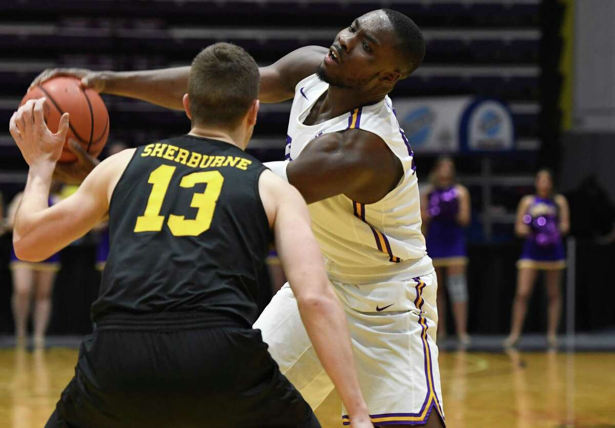 UAlbany forward Devonte Campbell fakes a pass in front of UMBC forward Joe Sherburne during a game on Saturday, Feb. 23, 2019 at SEFCU Arena in Albany, N.Y. (Jenn March, Special to the Times Union)