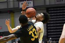 The ball hits UAlbany forward Malachi De Sousa as UMBC forward Arkel Lamar grapples for it during a game on Saturday, Feb. 23, 2019 at SEFCU Arena in Albany, N.Y. (Jenn March, Special to the Times Union)