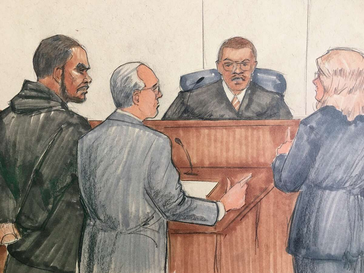 In this courtroom sketch, R&B singer R. Kelly appears before Cook County Judge John Fitzgerald Lyke Jr. at the Leighton Criminal Courthouse, Saturday, Feb. 23, 2019 in Chicago. The judge has set Kelly?s bond at $1 million saying that the amount equals $250,000 for each of the four people he?s charged with sexually abusing. (AP Photo/Tom Gianni)