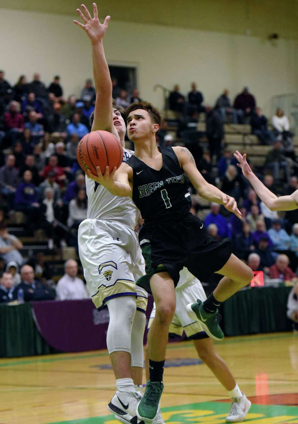 Green TechOs Joshua Rodriguez leaps toward the net during a game against CBA on Saturday, Feb. 23, 2019 at the McDonough Complex in Troy, NY. (Phoebe Sheehan/Times Union)