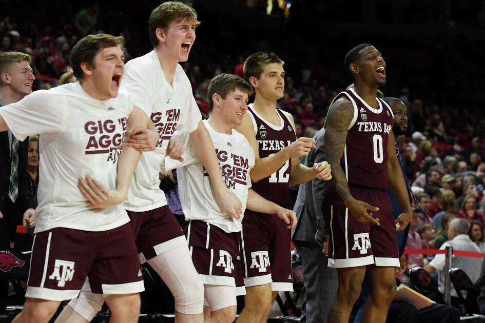 Texas A&M players react as their team rallies late in the second quarter during an NCAA college basketball game, Saturday, Feb. 23, 2019, in Fayetteville, Ark. (AP Photo/Michael Woods)