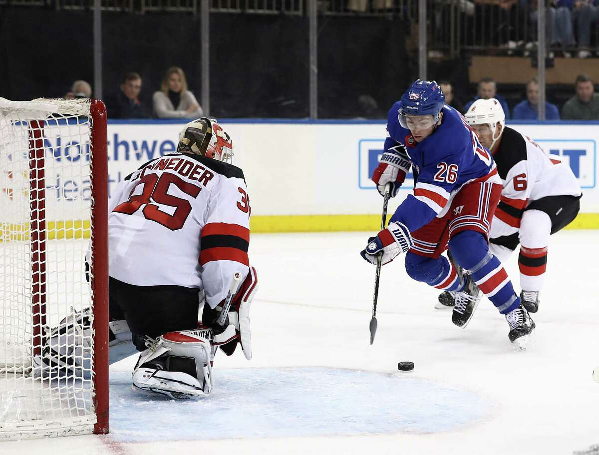 NEW YORK, NEW YORK - FEBRUARY 23: Jimmy Vesey #26 of the New York Rangers shoots against Cory Schneider #35 of the New Jersey Devils during their game at Madison Square Garden on February 23, 2019 in New York City. (Photo by Al Bello/Getty Images)
