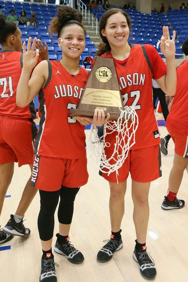 Judson's Corina Carter (left) and Kyra White hold the Rockets' third straight regional championship trophy. They will face Allen in the state semifinals. Photo: Marvin Pfeiffer / / Express-News 2019