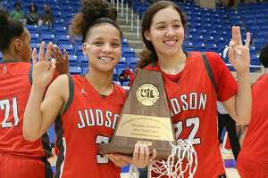 Judson's Corina Carter (left) and Kyra White hold the Rockets' third straight regional championship trophy. They will face Allen in the state semifinals.