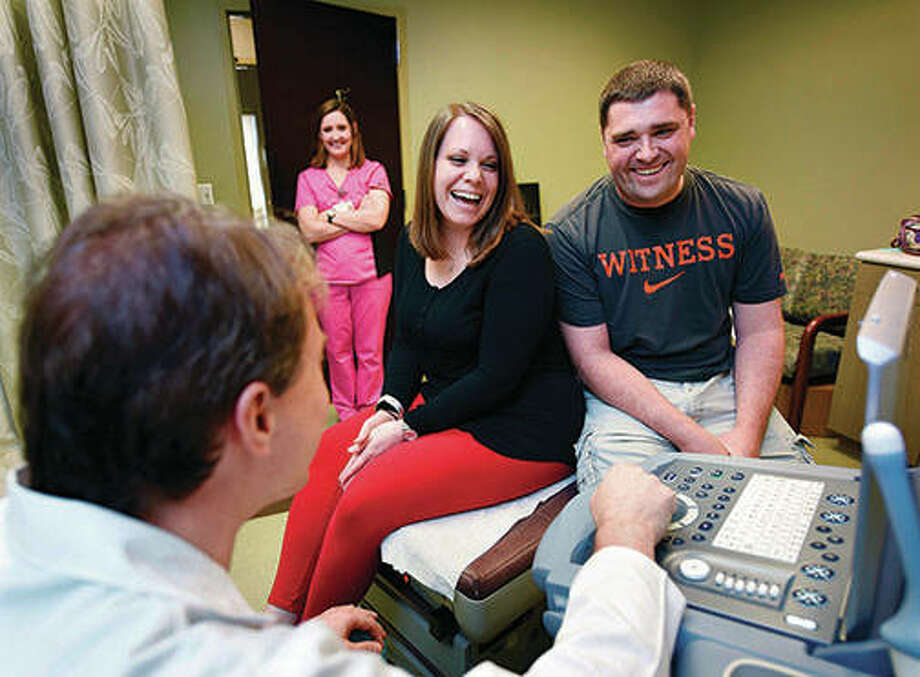 Trisha and Brett Gibson laugh with Dr. Preston Parry while reviewing Trisha's sonogram at a University of Mississippi Medical Center's Women's Specialty Clinic in Flowood, Mississippi. Photo: Joe Ellis | Clarion-Ledger (AP)