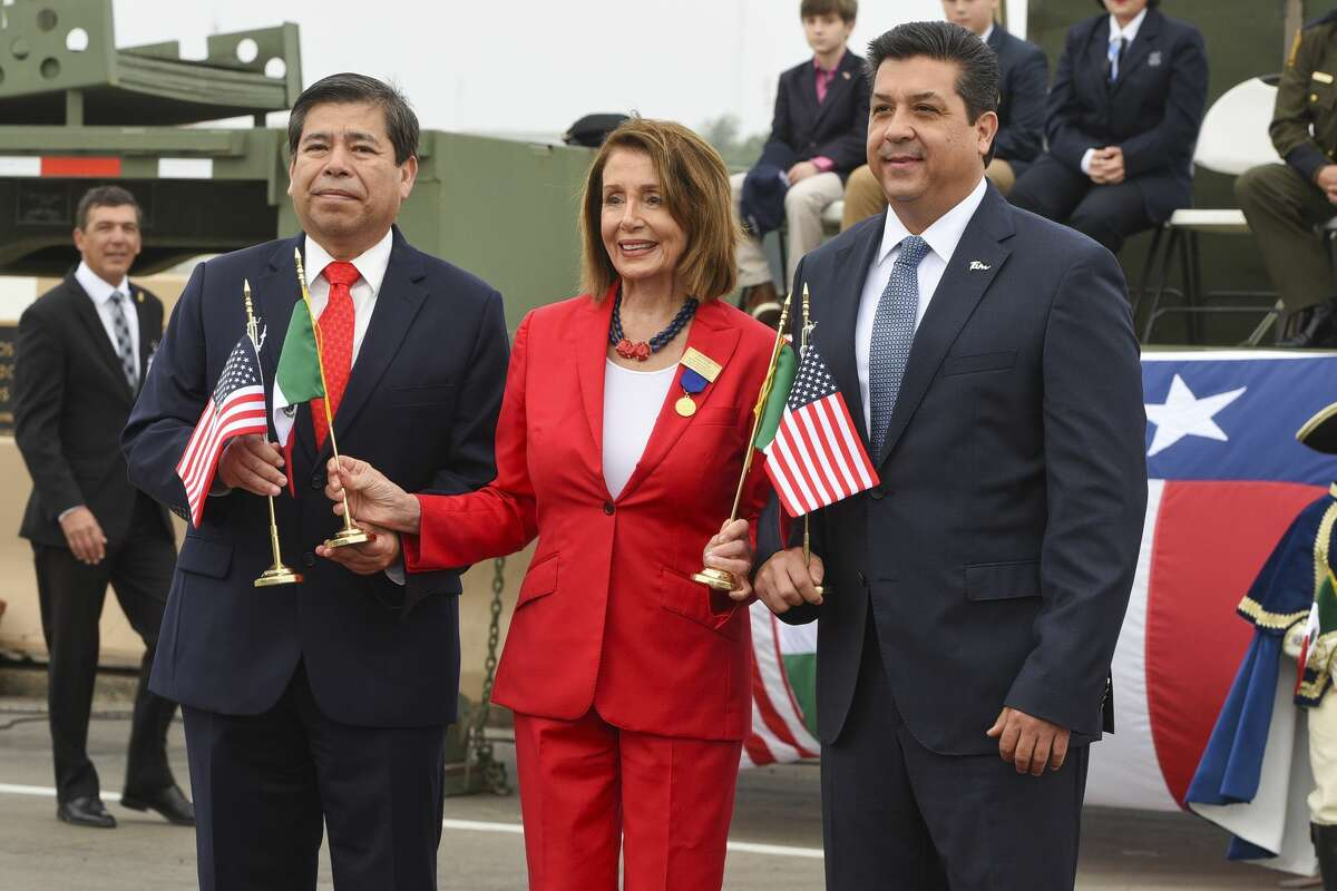 Commissioner of the National Institute of Migration Dr. Tonatiuh Guillén López, U.S. Speaker of the House Nancy Pelosi and Governor of the Mexican state of Tamaulipas Honorable Mr. Francisco Garcia Cabeza De Vaca meet at the middle of Juarez-Lincoln International Bridge on Saturday, Feb. 23, 2019, during the WBCA International Good Neighbor Council International Bridge Ceremony sponsored by La Posada Hotel.