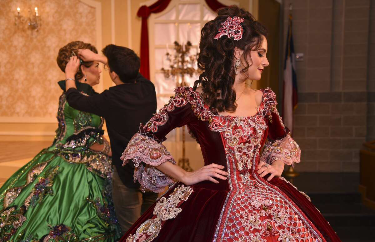 Debutante Alexandra Pellegrino Guardado displays her dress during the Society of Martha Washington Colonial Pageant Dress Rehearsal on Thursday, Feb. 21, 2019, at the TAMIU Center for the Fine and Performing Arts.
