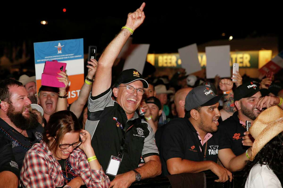 The crowd cheers for their favorite teams during the 2019 Houston Livestock Show and Rodeo World's Championship Bar-B-Que Contest.