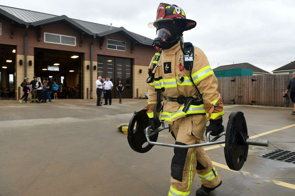 A firefighter finishes the 135 lb. hex bar farmers carry portion of the Spring Fire Department's Firefighter Challenge held at Spring Fire Station 78 on Feb. 23, 2019.