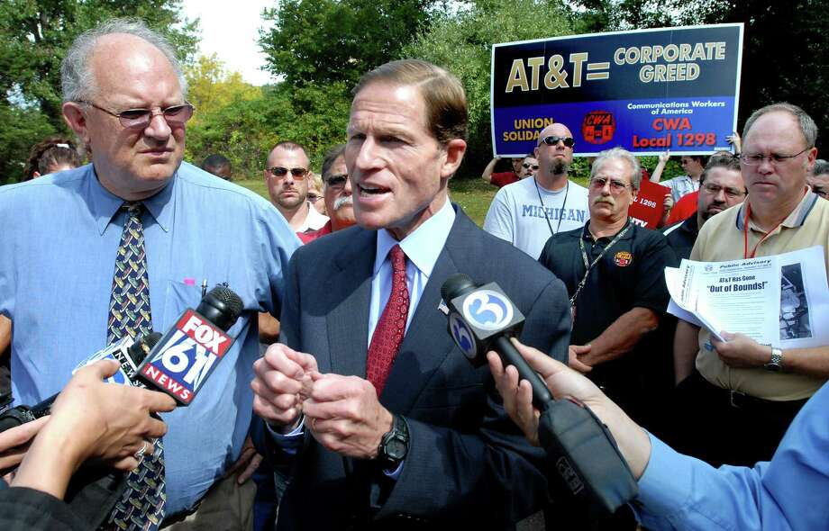 Bill Henderson III (left), president of the Communications Workers of America Local 1298, and Attorney General Richard Blumenthal (center) protest job cuts announced by AT&T outside of an AT&T call center in Meriden on 9/23/2009. Photo by Arnold Gold AG0334B