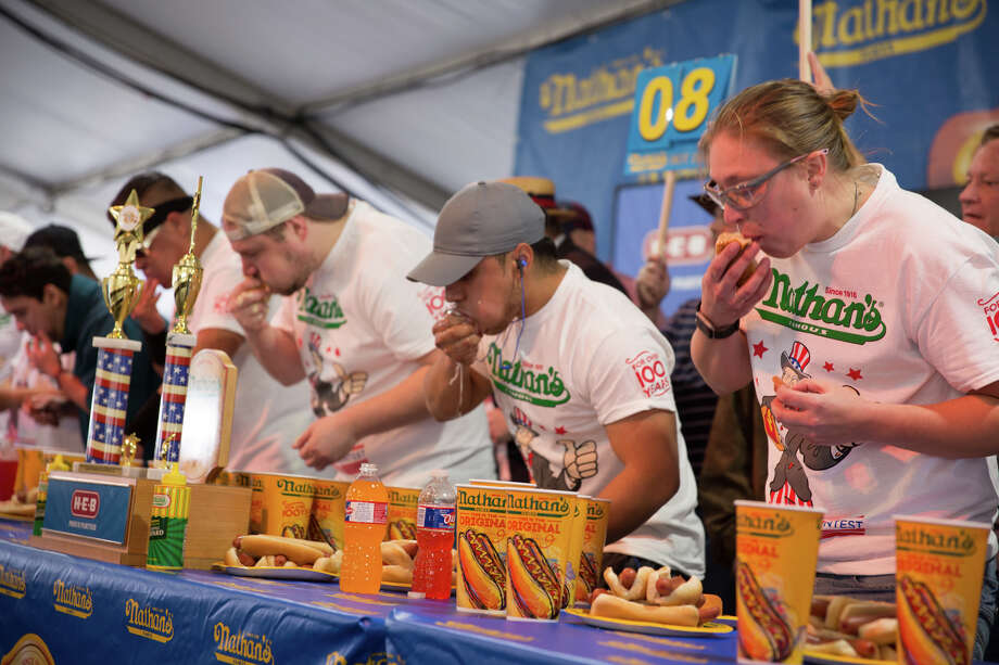 San Antonians competed for a shot at food glory at the hot dog-eating contest at the San Antonio Stock Show & Rodeo on Saturday, Feb. 23, 2019. Nathan's Famous, in a partnership with H-E-B, hosted its Texas qualifier for Fourth of July International Hot Dog Eating Contest in Brooklyn's Coney Island. Photo: B. Kay Richter, For MySA.com