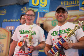 San Antonians competed for a shot at food glory at the hot dog-eating contest at the San Antonio Stock Show & Rodeo on Saturday, Feb. 23, 2019. Nathan's Famous, in a partnership with H-E-B, hosted its Texas qualifier for Fourth of July International Hot Dog Eating Contest in Brooklyn's Coney Island.