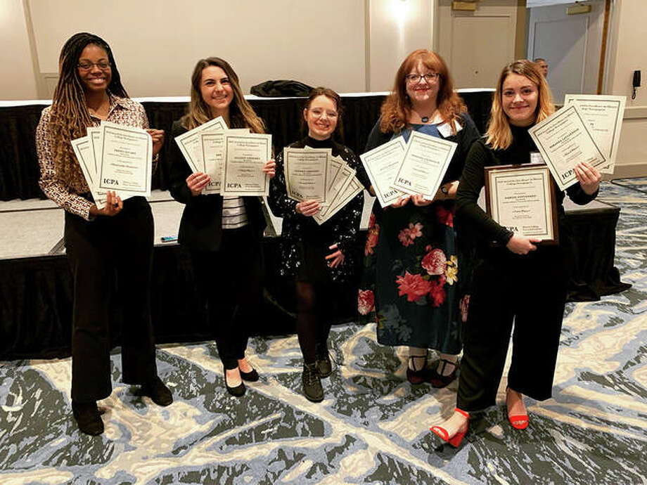 From left, JoAnn Weaver, Bridget Christner, Kait Baker, Tammy Merrett and Miranda Lintzenich hold The Alestle staff's collective IPCA awards. Photo: Photo Courtesy The Alestle