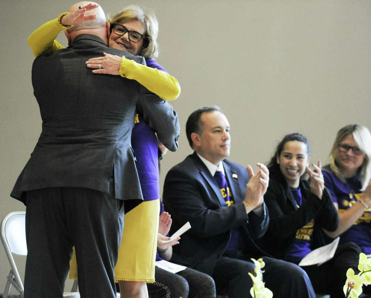"""Former State Rep. Mike Bocchino is hugged by Principal Barbara Riccio following his remarks to the audience during the """"New"""" New Lebanon School community open house and tour of the newly constructed next generation school on Saturday, Feb. 23, 2019 in Greenwich, Connecticut."""