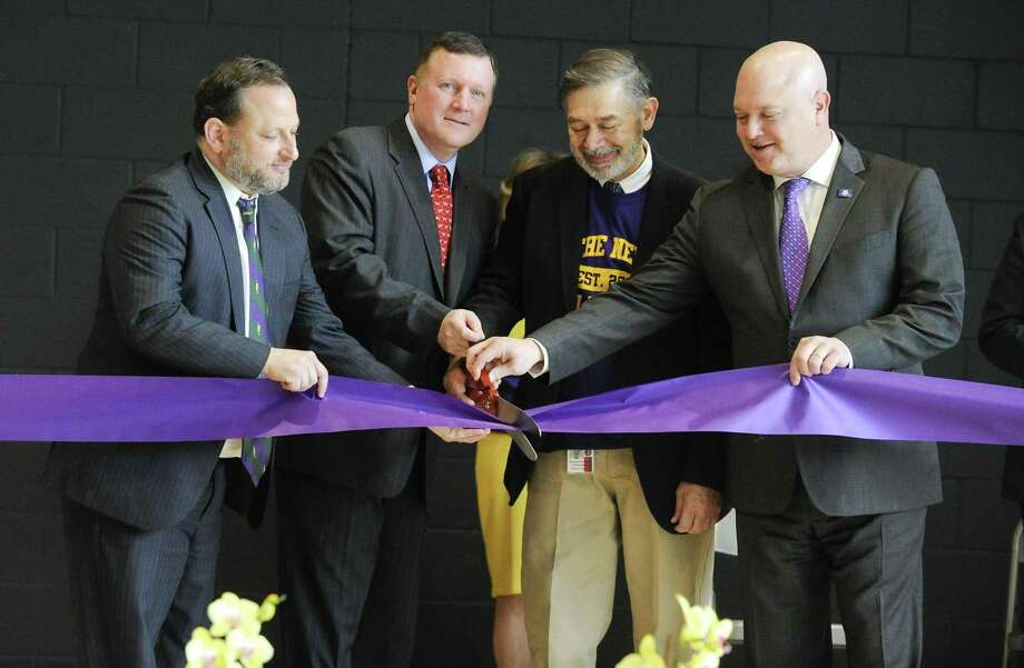 "From left, Peter Bernstein, Steve Walko, Superintendent of School Ralph Mayo and Former State Rep. Mike Bocchino prepare to cut a ribbon to officially open the ""New"" New Lebanon School during community open house and tour of the newly constructed next generation school on Saturday, Feb. 23, 2019 in Greenwich, Connecticut. Photo: Matthew Brown / Hearst Connecticut Media / Stamford Advocate"