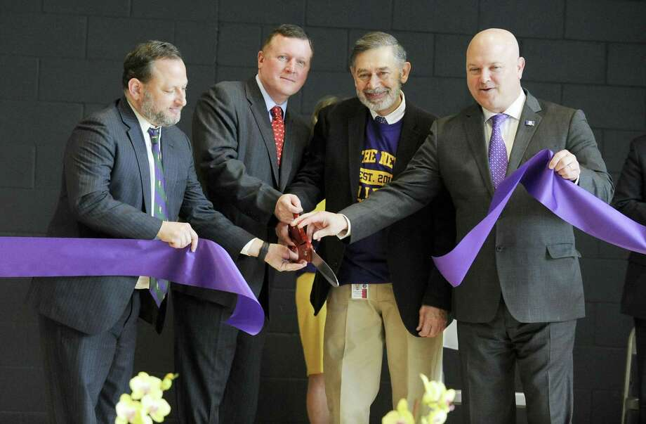 """From left, Peter Bernstein, Steve Walko, Superintendent of School Ralph Mayo and Former State Rep. Mike Bocchino officially open the """"New"""" New Lebanon School during community open house and tour of the newly constructed next generation school on Saturday, Feb. 23, 2019 in Greenwich, Connecticut. Photo: Matthew Brown / Hearst Connecticut Media / Stamford Advocate"""