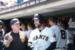 Mac Williamson (51) is congratulated after a score at the Giants vs. Marlins game at the AT&T Park on Wednesday, June 20, 2018 in San Francisco, Calif.