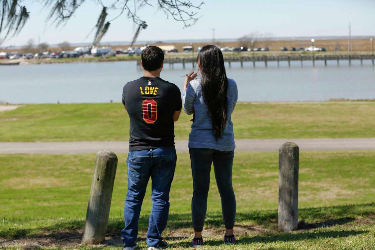 A couple who asked not to be identified, traveled from Houston to pay their respect near the wreckage of a Boeing 767 cargo jetliner contracted by Amazon that crashed into Trinity Bay Sunday, Feb. 24, 2019, in Anahuac.