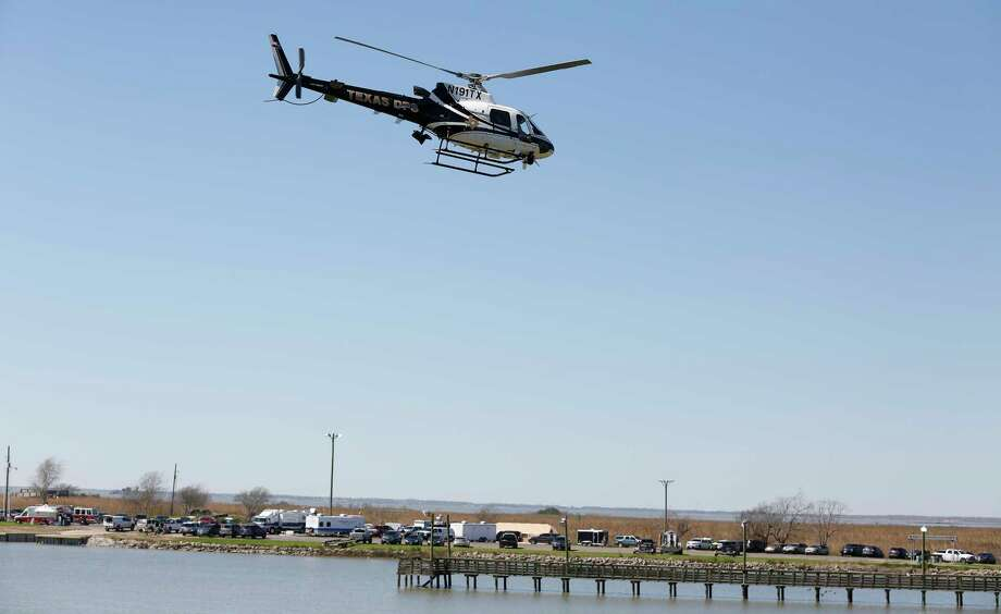 A Texas DPS helicopter heads to survey the wreckage of a Boeing 767 cargo jetliner contracted by Amazon that crashed into Trinity Bay Sunday, Feb. 24, 2019, in Anahuac. Photo: Steve Gonzales, Staff Photographer / © 2019 Houston Chronicle