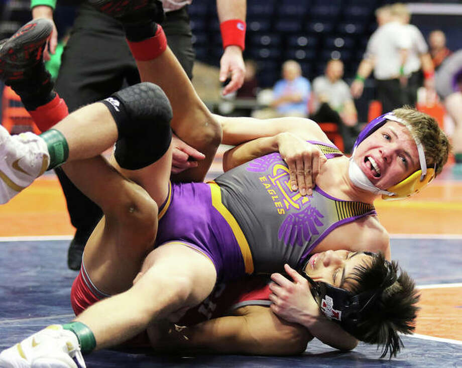 CM sophomore Caine Tyus (top) battles to gain an advantage on Antioch's Danny McPherson during the fifth-place match at 126 pounds in the Class 2A state tournament on Feb. 16 in Champaign. McPherson won a 2-1 decision. Photo: Greg Shashack / The Telegraph
