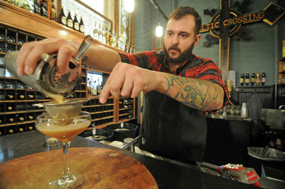 Bar manager Rory Morse mixes Post Commons' new offering, a cold brew coffee martini. Photo: David Blanchette | For The Telegraph