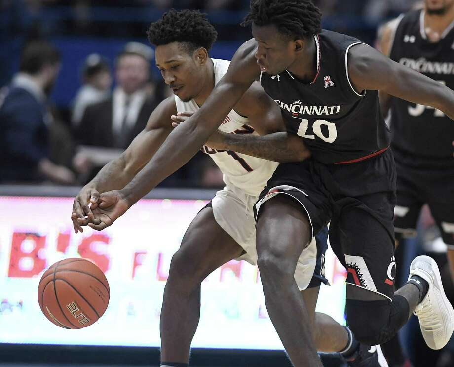 UConn's Christian Vital (1) tangles with Cincinnati's Mamoudou Diarra (20) on Sunday at the XL Center in Hartford. Photo: Jessica Hill / Associated Press / Copyright 2019 The Associated Press. All rights reserved