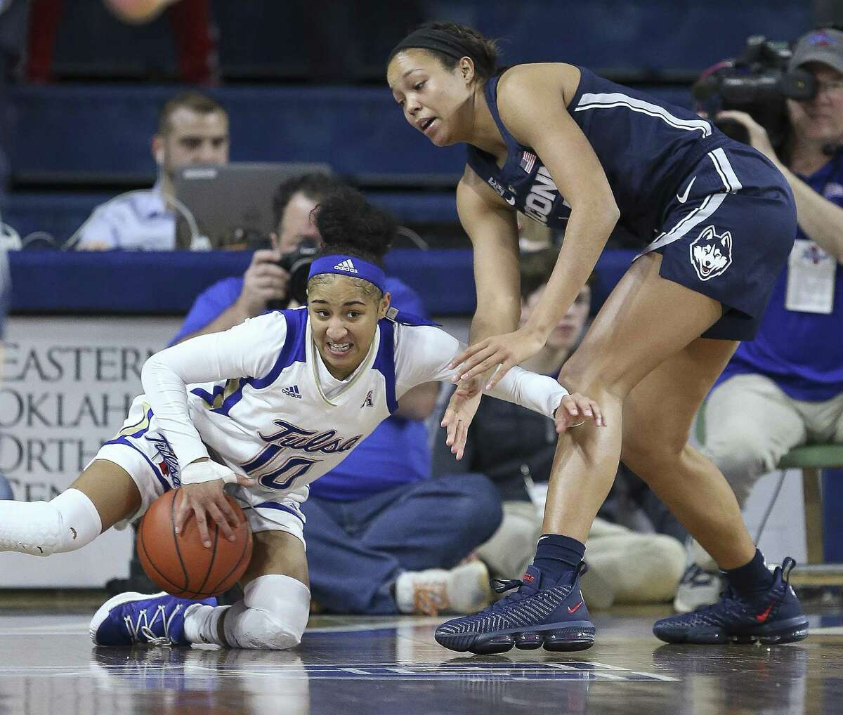 Tulsa's Alexis Gaulden and UConn's Napheesa Collier battle for the ball during the first half on Sunday.