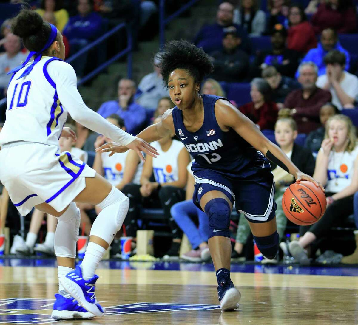UConn's Christyn Williams drives around Tulsa's Alexis Gaulden during the first half of a game in Tulsa, Okla., on Feb. 24, 2019.
