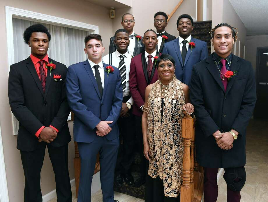 Carroll E. Brown (center), president and founder of the West Haven Black Coalition, is photographed with the Developing Tomorrow's Professionals area high school students (from left) Shane Clarke, Ariel Navarro, Caleb Yalartar, Abdel Mohamednoor, Taylor Marks, Awaab Osman, Mufee Cooper and Kamrean Staton at the Carroll E. Brown Scholarship & Community Awards Dinner at Fantasia in North Haven on Feb. 23, 2019. Photo: Arnold Gold / Hearst Connecticut Media / New Haven Register